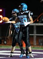 This MaxPreps.com professional photo is from the gallery Upper St. Clair vs. Woodland Hills (WPIAL Semifinal) which features Woodland Hills high school athletes playing  Football.