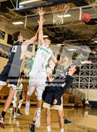 This MaxPreps.com professional photo is from the gallery Standley Lake vs. Legacy (Ralston Valley RoundUp) which features Standley Lake high school athletes playing  Basketball.
