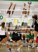 This MaxPreps.com professional photo features Lebanon Trail high school Kacie Johnson and Rayna Williams playing  Volleyball. This photo was shot by Gregory LaGrange and published on LaGrange.