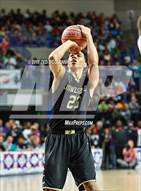 This MaxPreps.com professional photo is from the gallery El Dorado vs. Jonesboro (AAA 6A Final) which features Jonesboro high school athletes playing  Basketball.