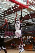 This MaxPreps.com professional photo is from the gallery Upland vs Chino Hills (Ayala Dogfight Tournament) which features Chino Hills high school athletes playing  Basketball.