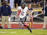 This MaxPreps.com professional photo features Trinity Christian high school Trevon Jones playing  Football. This photo was shot by Alik McIntosh and published on McIntosh.