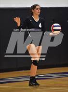 This MaxPreps.com professional photo is from the gallery Currituck County @ Carrboro (NCHSAA 2A East Final) which features Carrboro high school athletes playing  Volleyball.