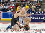 This MaxPreps.com professional photo is from the gallery PIAA Wrestling Championships (Class AAA Finals) which features Canon-McMillan high school athletes playing  Wrestling. This photo was shot by Ken Reabe Jr and published on Reabe Jr.