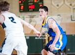 This MaxPreps.com professional photo features Serra high school Dillon Macaraig playing  Basketball. This photo was shot by Samuel Stringer and published on Stringer.