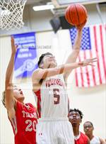 This MaxPreps.com professional photo features Lee high school Mike Nickles playing  Basketball. This photo was shot by Joe Calomeni and published on Calomeni.
