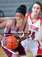 This MaxPreps.com professional photo is from the gallery Fort Bend Kempner vs Lee [Robert E.] (Mira's Texas Riviera Tournament) which features Fort Bend Kempner high school athletes playing Girls Basketball.