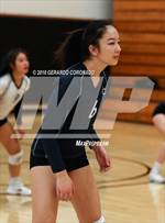 This MaxPreps.com professional photo features Carlmont high school Kayla Lunde playing  Volleyball. This photo was shot by Gerardo Coronado and published on Coronado.