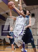 This MaxPreps.com professional photo features Shasta high school Yurri Abuyen playing  Basketball. This photo was shot by Michael Turner and published on Turner.