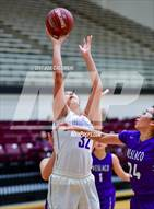 This MaxPreps.com professional photo is from the gallery Weslaco vs Edinburg (NEISD Invitational) which features Edinburg high school athletes playing Girls Basketball.