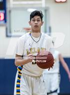 This MaxPreps.com professional photo is from the gallery Watsonville @ Leland which features Leland high school athletes playing  Basketball.
