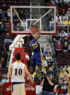 This MaxPreps.com professional photo is from the gallery Vaux vs. Johnsonburg (PIAA Class A Final) which features Vaux high school athletes playing  Basketball.