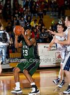 This MaxPreps.com professional photo is from the gallery Kingwood @ Hightower (McDonalds Texas Invitational) which features Fort Bend Hightower high school athletes playing  Basketball.