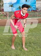 This MaxPreps.com professional photo is from the gallery Kahuku (Preseason Early Contenders Photo Shoot) which features Kahuku high school athletes playing  Football.